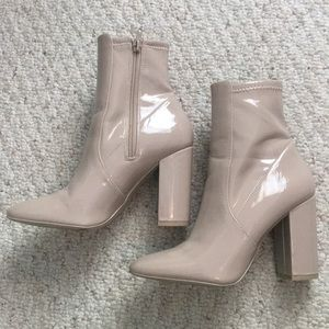 Nude heeled booties.